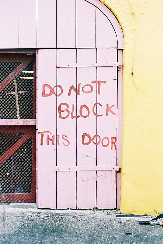 Door sign by Sam Burton for Stocksy United