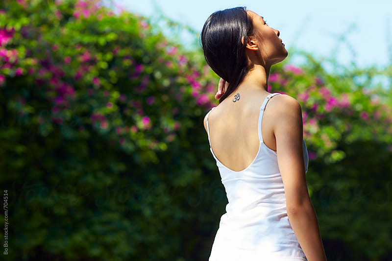 pretty young asian woman outdoor in summertime by cuiyan Liu for Stocksy United