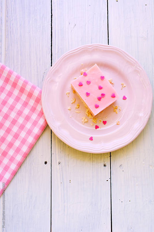 Pink cake with hearts by Pixel Stories for Stocksy United