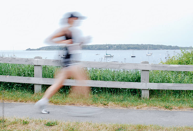Female athlete running in a race by Cara Dolan for Stocksy United