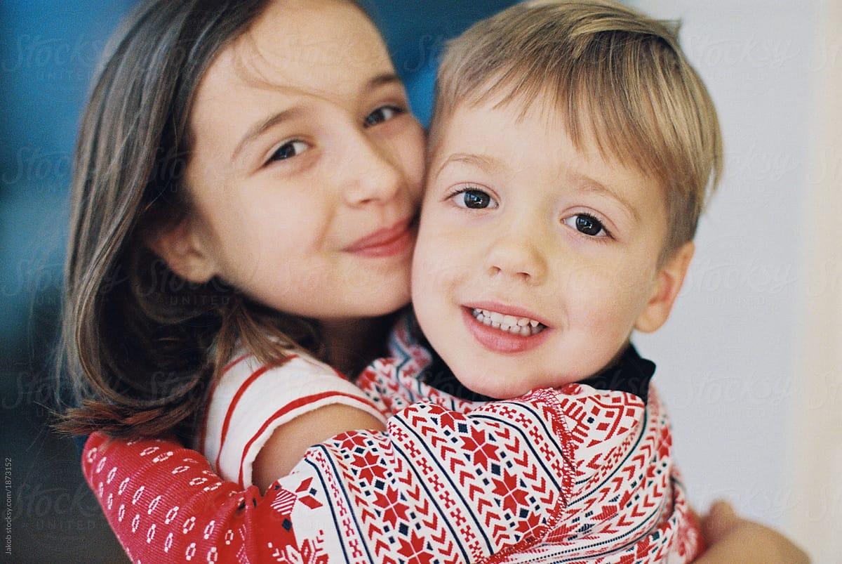 adorable siblings hugging each other stocksy united