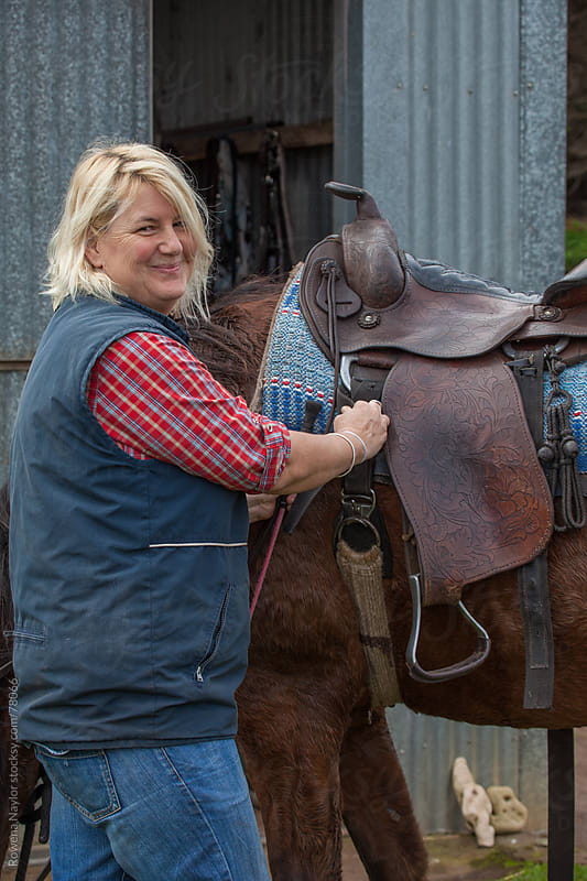 Horse Rider with her Old Hard Carved Leather Saddle by Rowena Naylor for Stocksy United