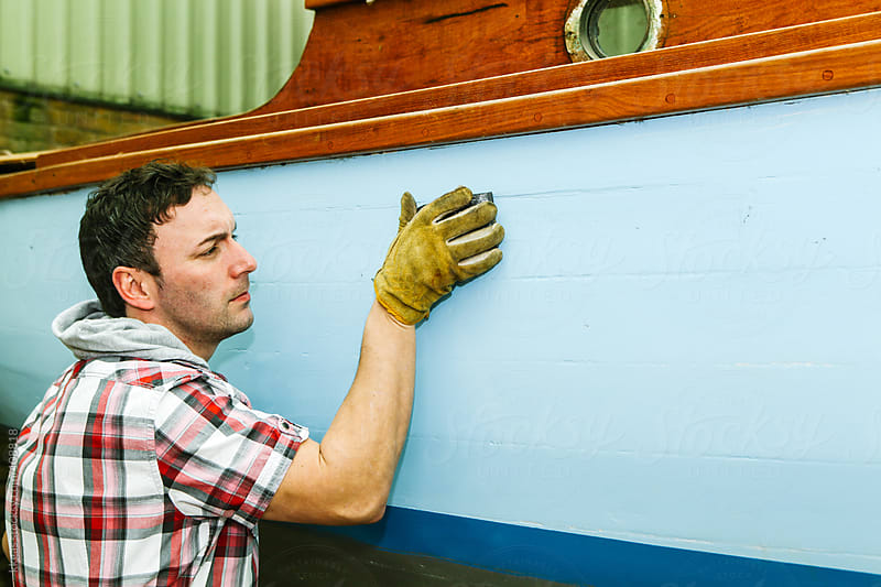 Man restoring an old sailing boat. by kkgas for Stocksy United