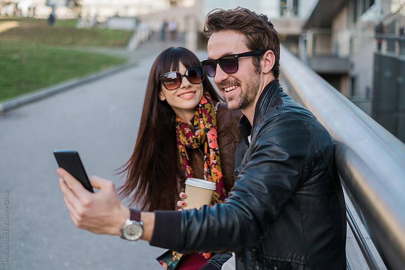 Man Taking Selfie on a Date by Mosuno for Stocksy United