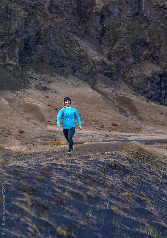 Fitness girl running outdoors by Søren Egeberg Photography for Stocksy United