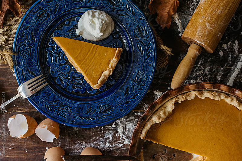 Pumpkin pie and slice from above by Gabriel (Gabi) Bucataru for Stocksy United