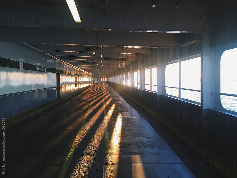 Interior car deck of empty ferry boat at dusk, Puget Sound, WA by Paul Edmondson for Stocksy United