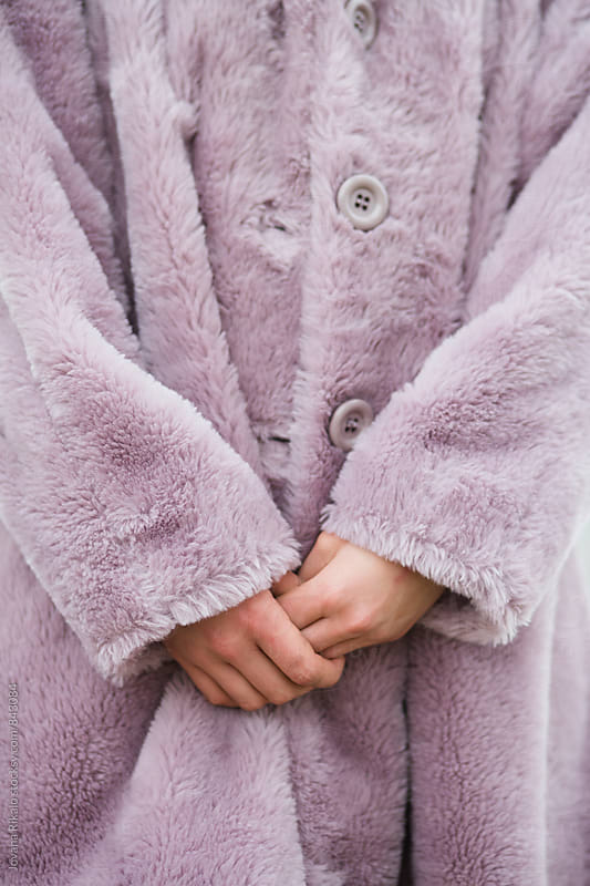 Close up of female hands and pink coat by Jovana Rikalo for Stocksy United