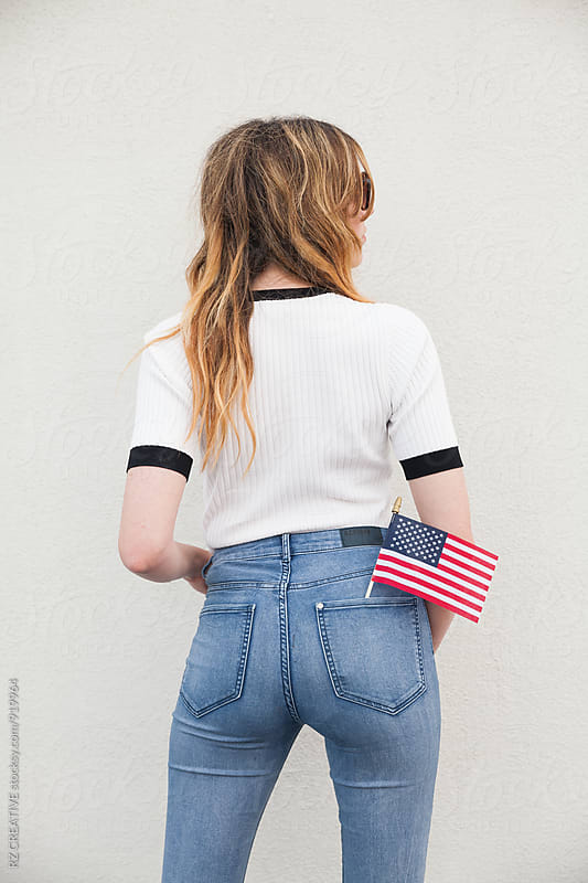 Woman with U.S. flag. by Robert Zaleski for Stocksy United