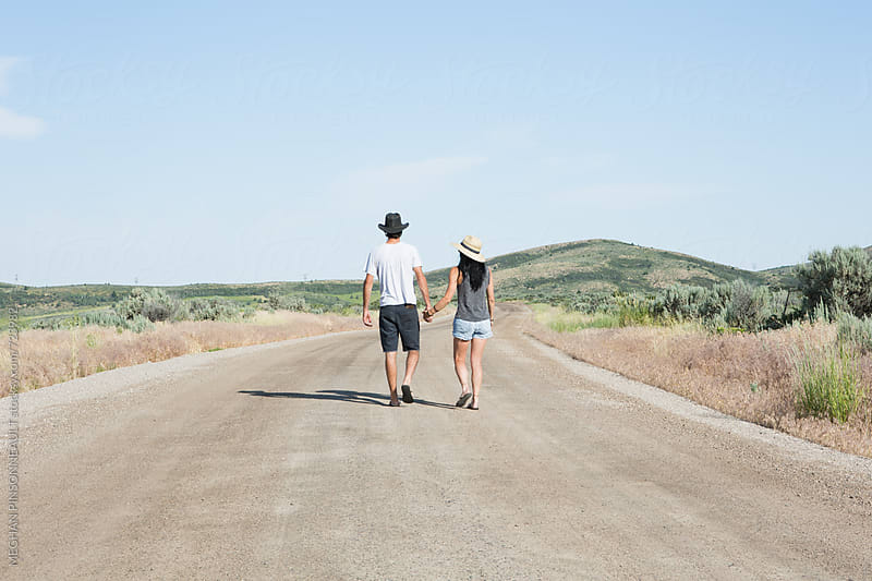 Couple Walking Down Country Road by Meg Pinsonneault for Stocksy United