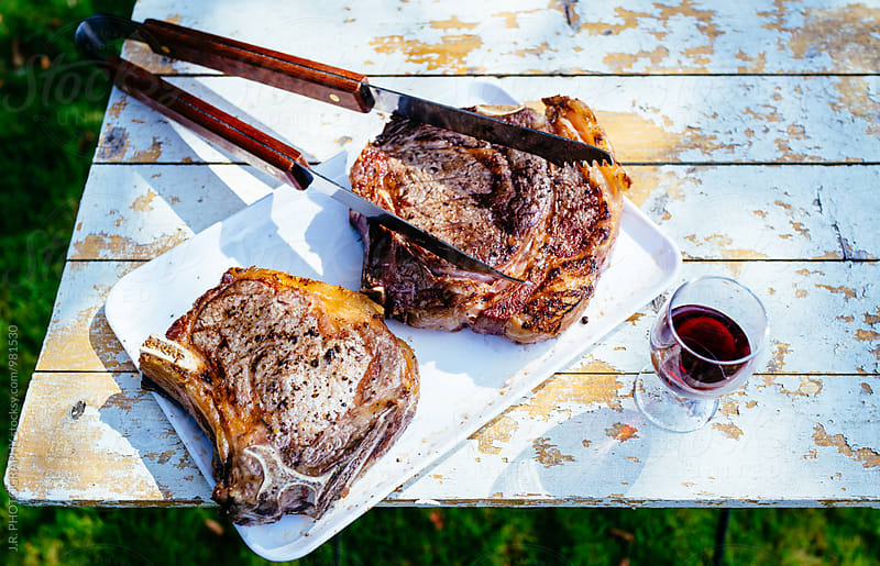 Grilled T-bone steak on garden table by J.R. PHOTOGRAPHY for Stocksy United