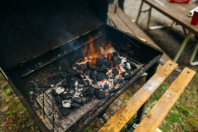 Briquettes Glowing With Heat In BBQ Grill by Luke Mattson for Stocksy United