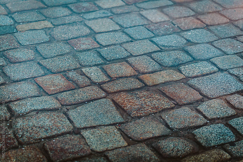 Cobblestone Road Covered by a Puddle by VICTOR TORRES for Stocksy United