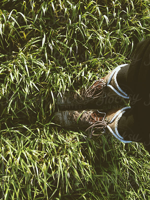 Walking boots and grass by Helen Rushbrook for Stocksy United