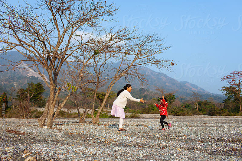 Happy child running towards her mother by Saptak Ganguly for Stocksy United