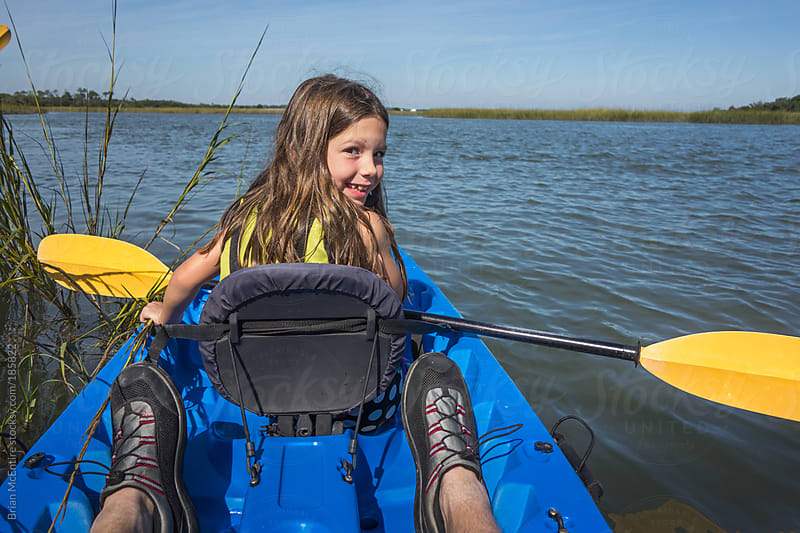 Adorable Girl, Excited During Family Kayaking Trip in Carolina Low Country by Brian McEntire for Stocksy United