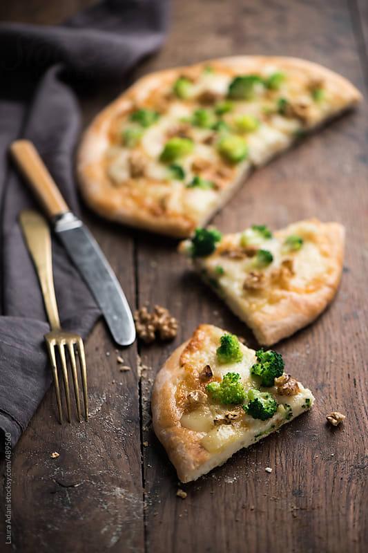 Italian pizza with taleggio cheese, broccoli and walnut by Laura Adani for Stocksy United
