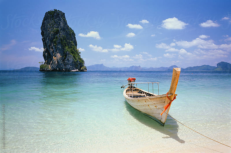 Traditional boat on the spectacular coast of Krabi. Thailand by Hugh Sitton for Stocksy United