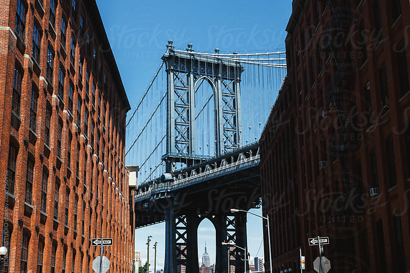 Views of Manhattan bridge from Dumbo district. by BONNINSTUDIO for Stocksy United