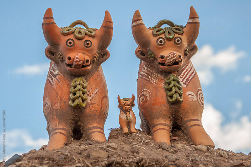 Clay cows on top of a house in Peru by Mike Marlowe for Stocksy United