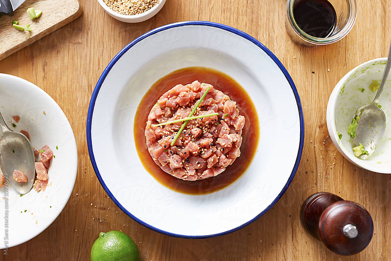 Round tuna tartare with soy sauce on plate by Martí Sans for Stocksy United