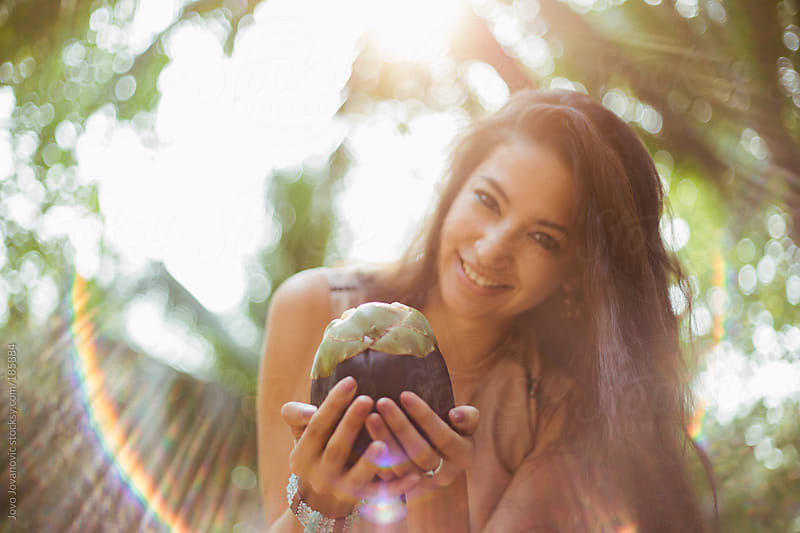 Beautiful woman holding exotic fruit in her hands by Jovo Jovanovic for Stocksy United