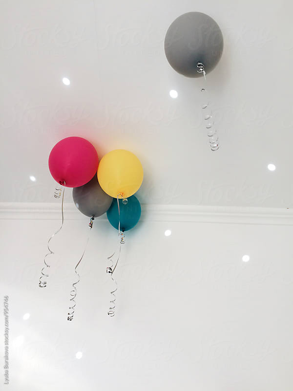 One balloon separated from others by Liubov Burakova for Stocksy United