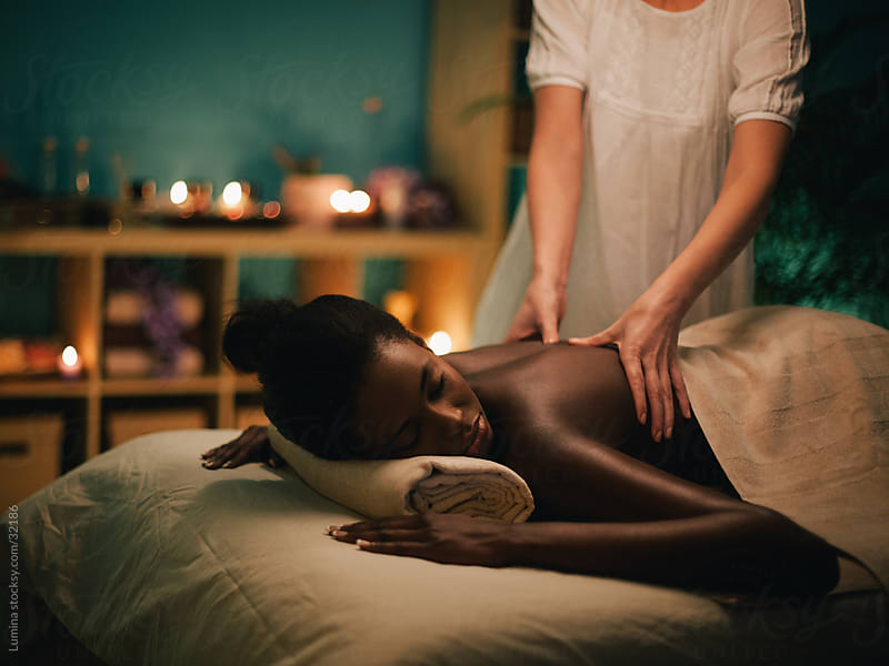 African Woman Enjoying a Massage by Lumina for Stocksy United