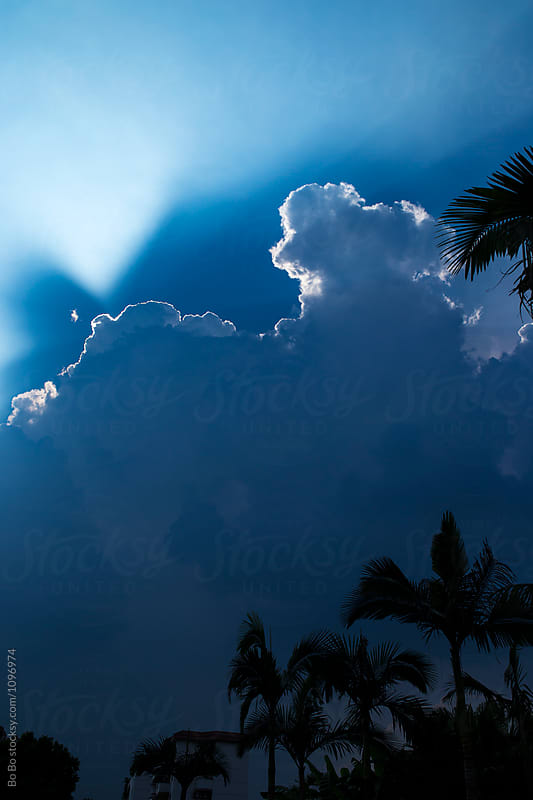 beam of sun light from the cloud by Bo Bo for Stocksy United