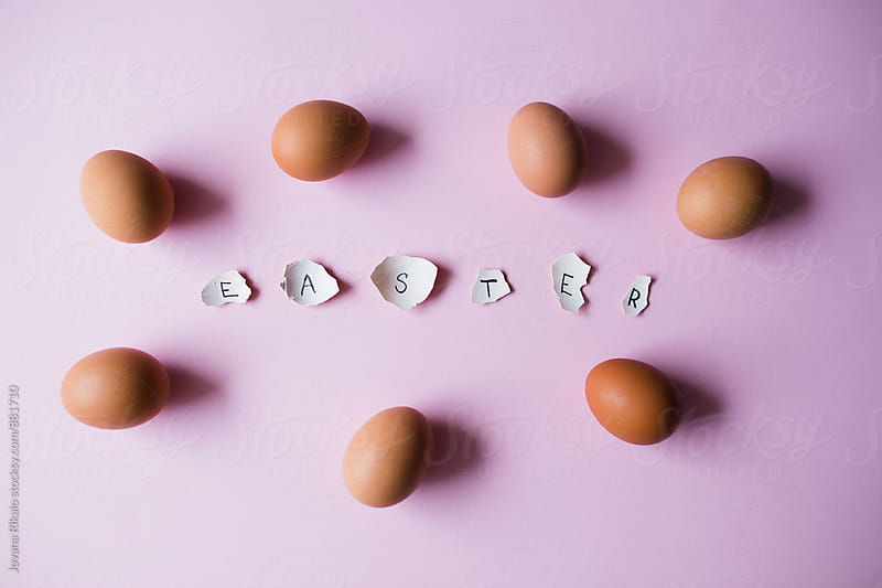 Easter letters made out of egg shells on a pink backgrond by Jovana Rikalo for Stocksy United