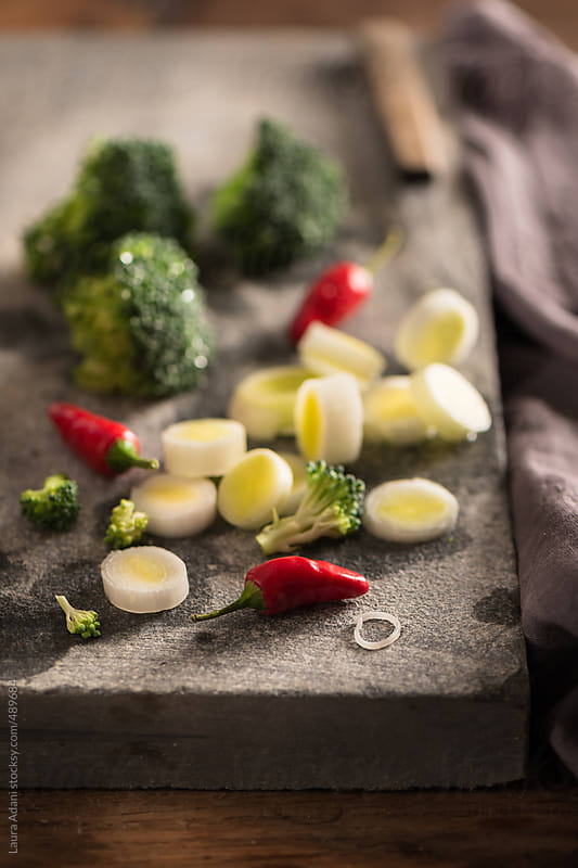 chopped vegetables  by Laura Adani for Stocksy United