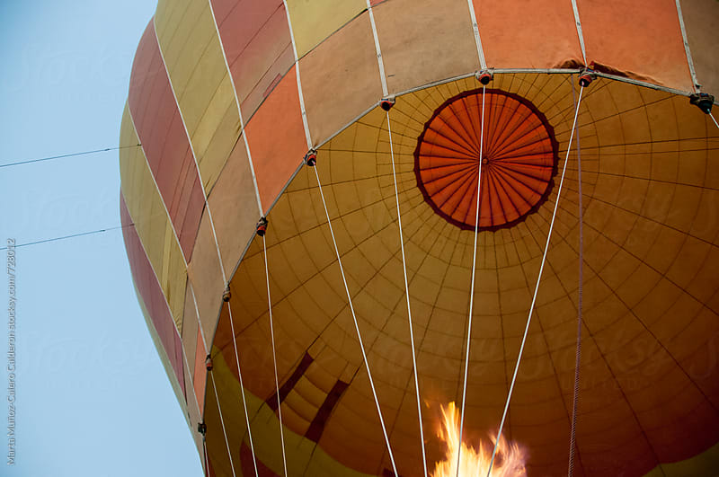 Looking up into a hot air balloon  by Marta Muñoz-Calero Calderon for Stocksy United