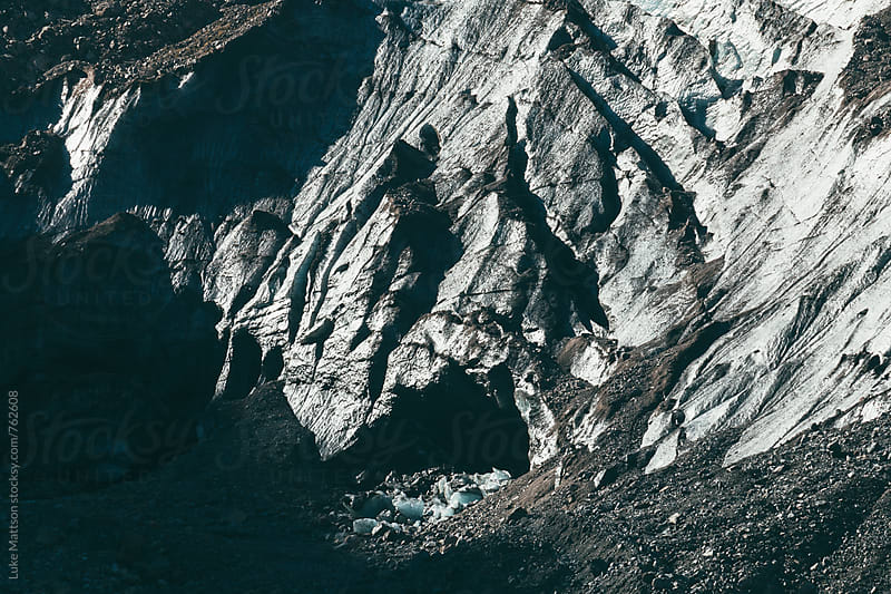Icy Gray Glacial Cave On Rocky Mountainside by Luke Mattson for Stocksy United