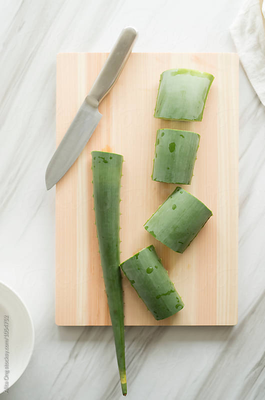 Aloe vera cut into pieces by Alita Ong for Stocksy United