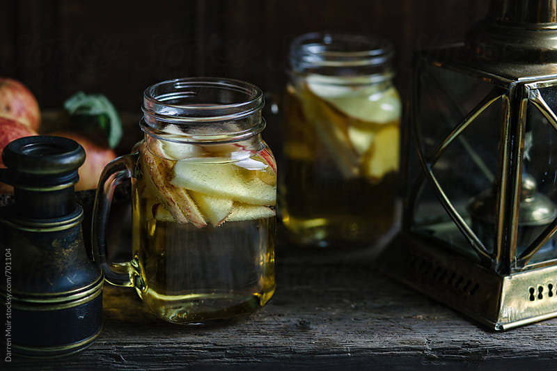Jugs of apple cider in a rustic still life setting. by Darren Muir for Stocksy United