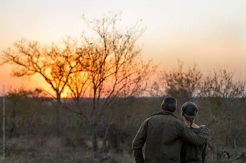 Sunset Couple by Bruce and Rebecca Meissner for Stocksy United