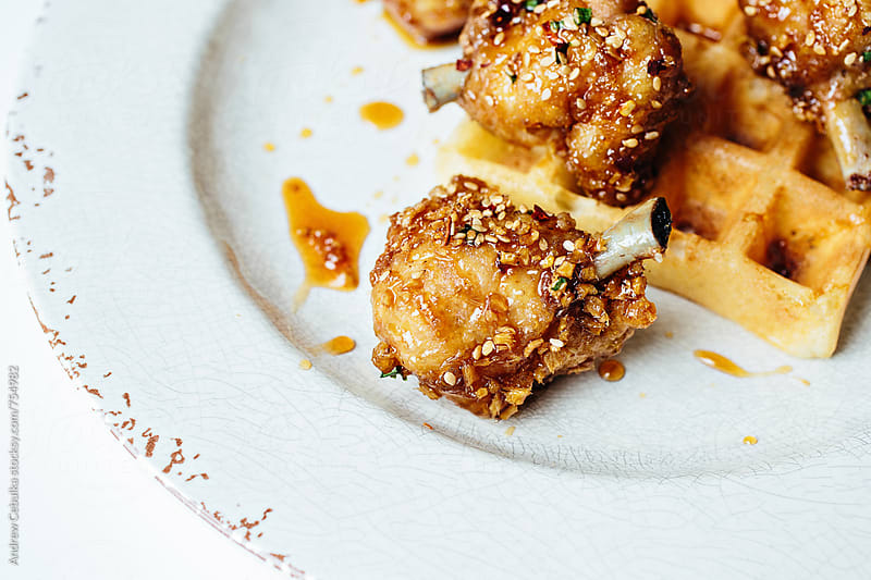 Fried Chicken and waffle by Andrew Cebulka for Stocksy United