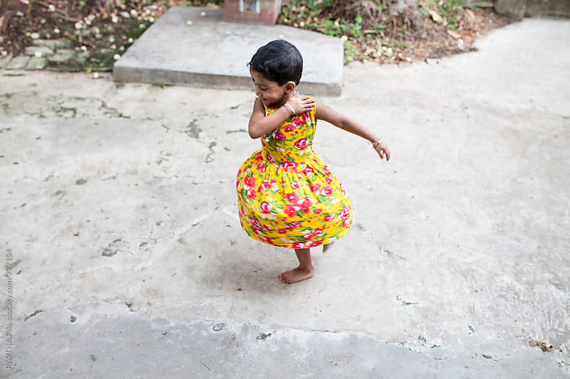 A little girl is dancing and enjoying herself by PARTHA PAL for Stocksy United