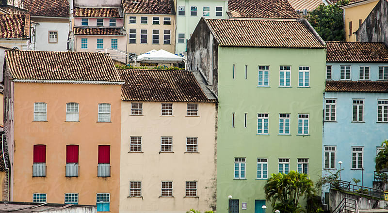 A row of pastel coloured building in Salvador, Brazil by Mike Marlowe for Stocksy United