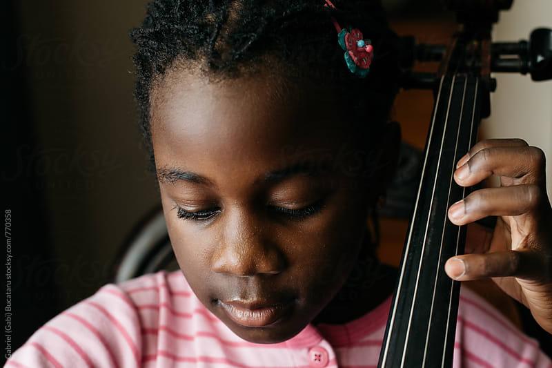 African American girl playing cello by Gabriel (Gabi) Bucataru for Stocksy United