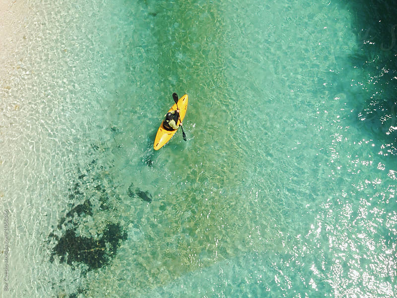 Kayak in blue water by Bor Cvetko for Stocksy United