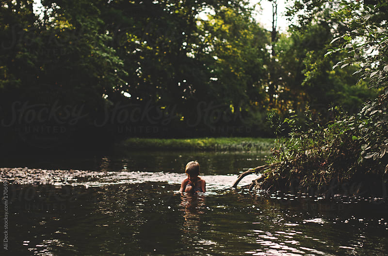 A Boy Playing in Water by Ali Deck for Stocksy United