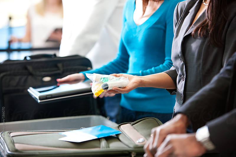 Airport: Removing Plastic Bag of Toiletry Items by Sean Locke for Stocksy United