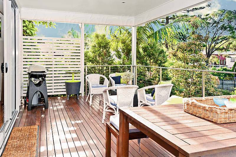 back verandah on a queenslander home, with bbq and outdoor furniture by Gillian Vann for Stocksy United