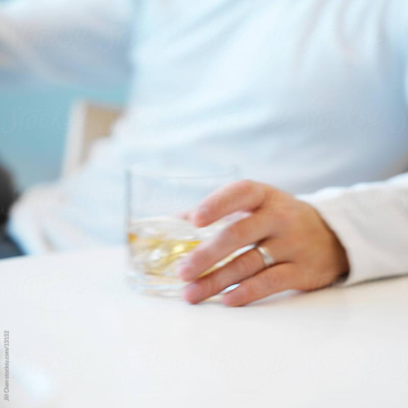 Scotch Drinker by Jill Chen for Stocksy United