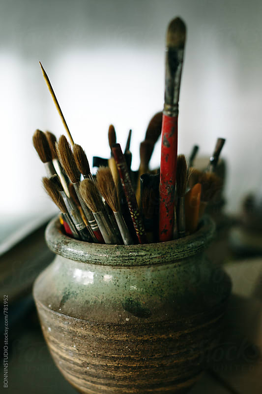 Brushes in a ceramic vase. by BONNINSTUDIO for Stocksy United