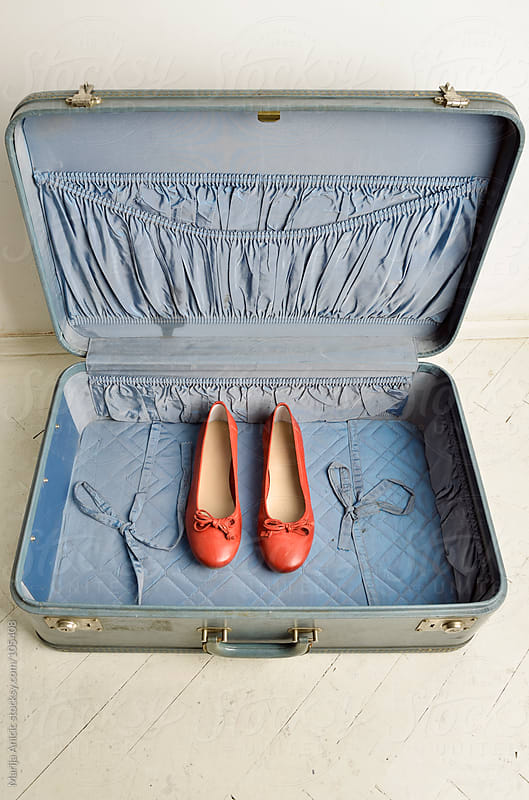 old suitcase and flats by Marija Anicic for Stocksy United