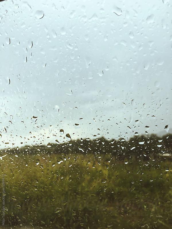 Car window with rain drops by Maja Topcagic for Stocksy United