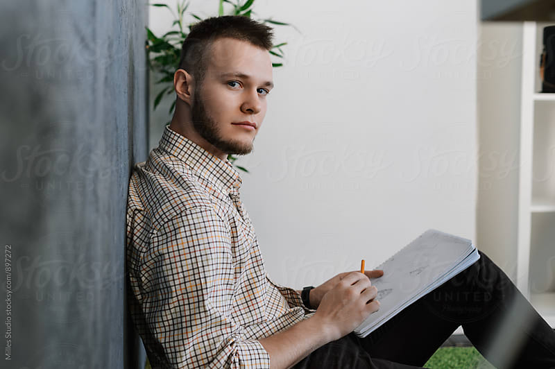 Young man at office by Milles Studio for Stocksy United