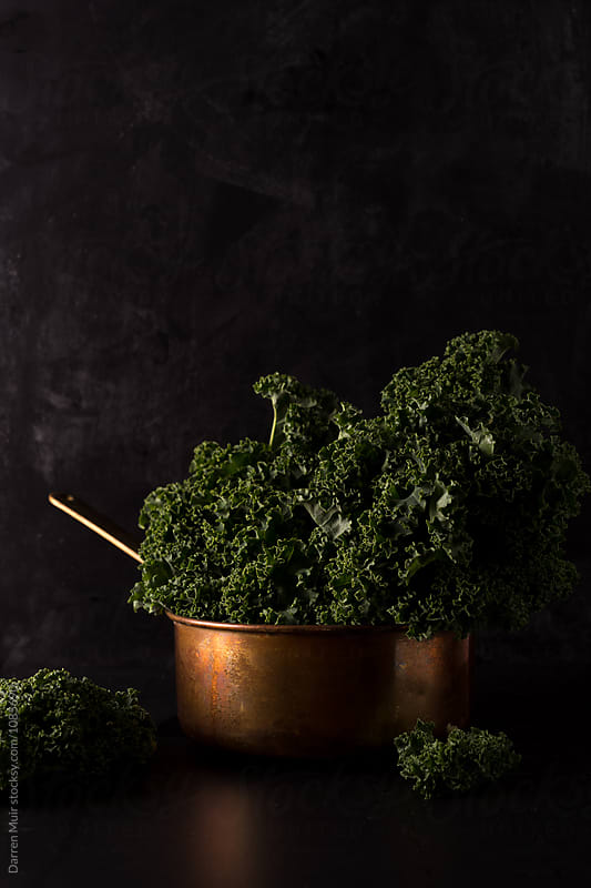 Bunch of kale in a copper pot. by Darren Muir for Stocksy United